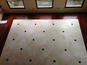 Sapele-Floor-honed-travertine-inlay